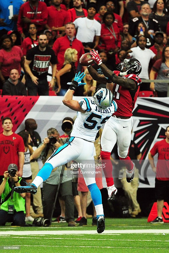 Julio Jones #11 of the Atlanta Falcons makes a catch for a touchdown over Luke Kuechly #59 of the Carolina Panthers during the second half at the Georgia Dome on December 27, 2015 in Atlanta, Georgia.