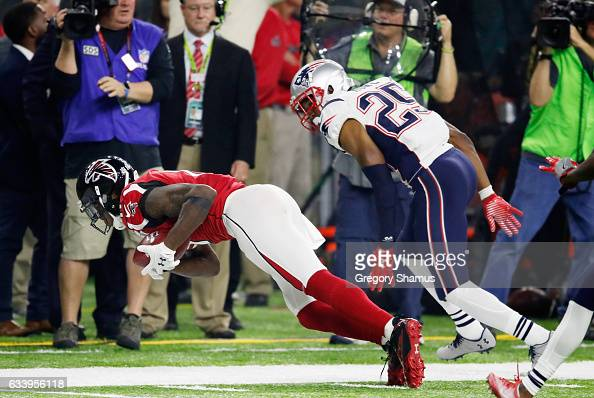 Julio Jones of the Atlanta Falcons makes a catch over Eric Rowe of the New England Patriots in the fourth quarter during Super Bowl 51 at NRG Stadium...