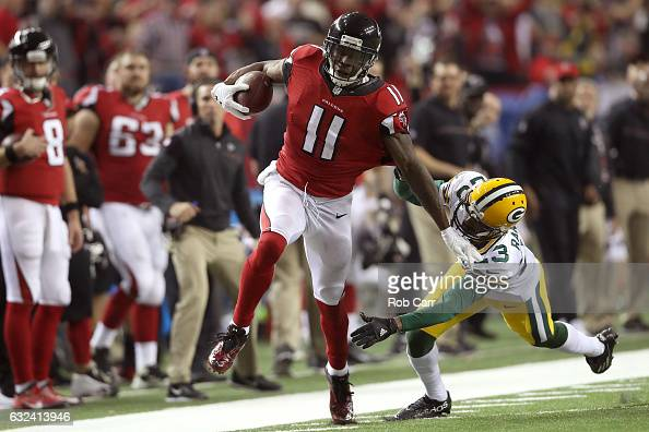 Julio Jones of the Atlanta Falcons runs after a catch for a 73 yard touchdown against Damarious Randall of the Green Bay Packers in the third quarter...