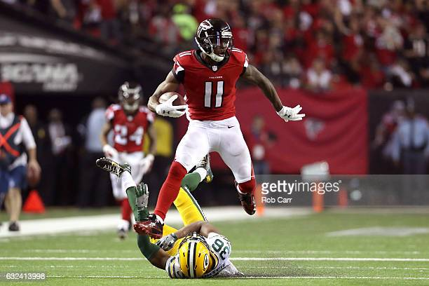 Julio Jones of the Atlanta Falcons runs after a catch for a 73 yard touchdown against LaDarius Gunter of the Green Bay Packers in the third quarter...