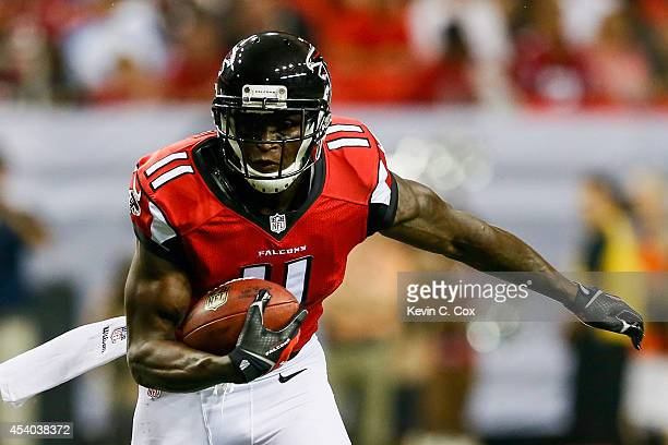 Julio Jones of the Atlanta Falcons runs after a catch for a touchdown in the first half of a preseason game against the Tennessee Titans at the...