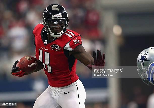 Julio Jones of the Atlanta Falcons runs for a touchdown against the Dallas Cowboys at ATT Stadium on September 27 2015 in Arlington Texas