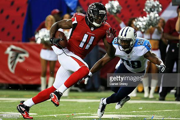 Julio Jones of the Atlanta Falcons runs past Perrish Cox of the Tennessee Titans on route for a touchdown in the first half of a preseason game at...