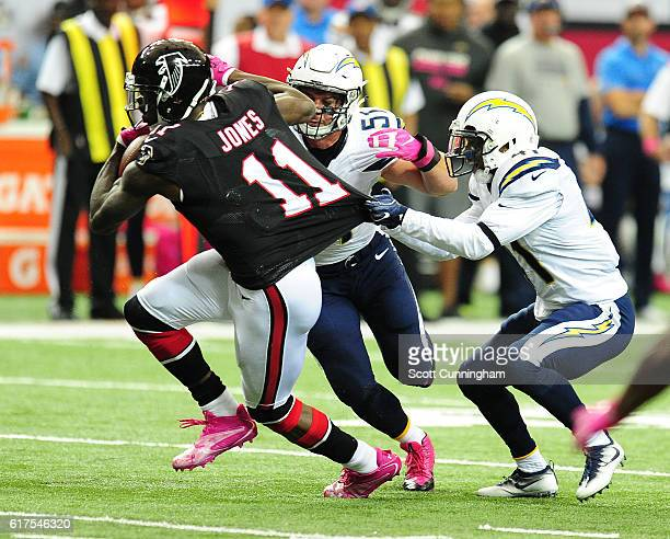 Julio Jones of the Atlanta Falcons runs with a catch against Steve Williams and Kyle Emanuel of the San Diego Chargers at the Georgia Dome on October...