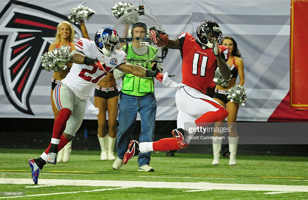 <a gi-track='captionPersonalityLinkClicked' href=/galleries/search?phrase=Julio+Jones&family=editorial&specificpeople=5509837 ng-click='$event.stopPropagation()'>Julio Jones</a> #11 of the Atlanta Falcons runs with a catch against Stevie Brown #27 of the New York Giants at the Georgia Dome on December 16, 2012 in Atlanta, Georgia