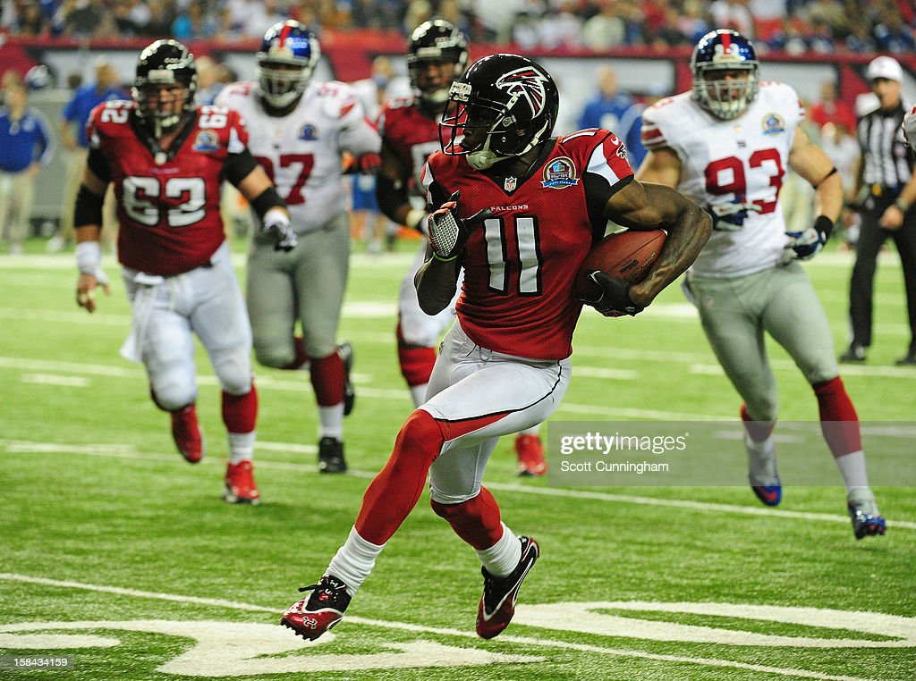 <a gi-track='captionPersonalityLinkClicked' href=/galleries/search?phrase=Julio+Jones&family=editorial&specificpeople=5509837 ng-click='$event.stopPropagation()'>Julio Jones</a> #11 of the Atlanta Falcons runs with a catch against the New York Giants at the Georgia Dome on December 16, 2012 in Atlanta, Georgia