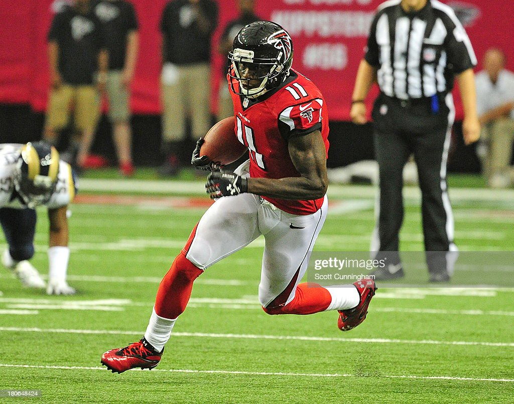 <a gi-track='captionPersonalityLinkClicked' href=/galleries/search?phrase=Julio+Jones&family=editorial&specificpeople=5509837 ng-click='$event.stopPropagation()'>Julio Jones</a> #11 of the Atlanta Falcons runs with a catch against the St. Louis Rams at the Georgia Dome on September 15, 2013 in Atlanta, Georgia.