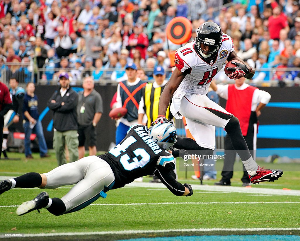 Julio Jones #11 of the Atlanta Falcons scores a touchdown against Haruki Nakamura #43 of the Carolina Panthers during play at Bank of America Stadium on December 9, 2012 in Charlotte, North Carolina. Carolina defeated Atlanta, 30-20.