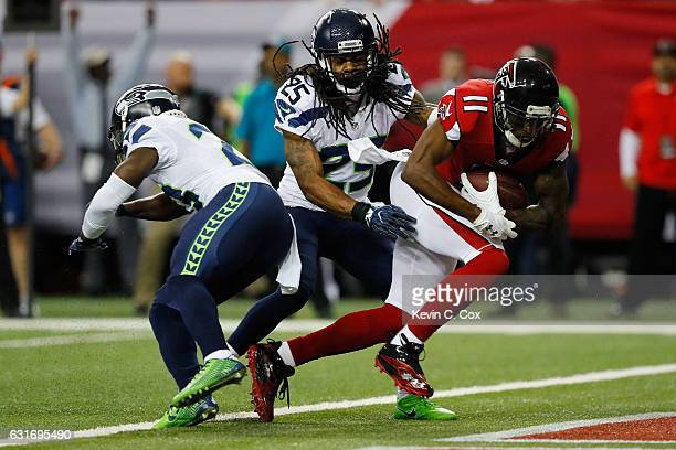 Julio Jones of the Atlanta Falcons scores a touchdown against Richard Sherman of the Seattle Seahawks at the Georgia Dome on January 14 2017 in...