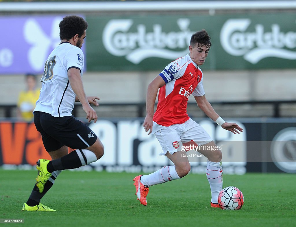 Julio Pleguezuelo of Arsenal is challenged by Mason Bennett of Derby during the match between Arsenal U21 and Derby County U21 at Meadow Park on August 21, 2015 in Borehamwood, England.