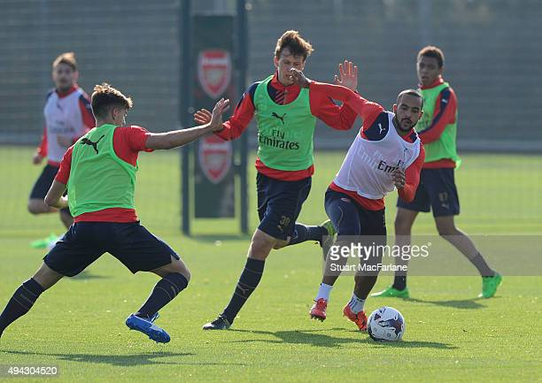 Julio Pleguezuelo Theo Walcott and Krystain Bielik of Arsenal during a training session at London Colney on October 26 2015 in St Albans England