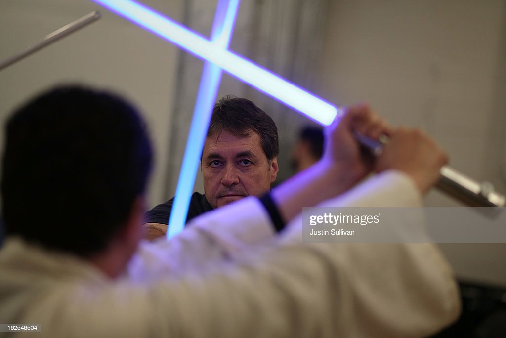 Julio Reyes (L) and Ron Nixon (R) practice combat moves with lightsabers during a Golden Gate Knights class in saber choreography on February 24, 2013 in San Francisco, California. Star Wars fans Alain Bloch and Matthew Carauddo founded the Golden Gate Knights in 2011 to teach classes on how to safely wield a lightsaber and perform choreographed moves. The three hour class costs ten dollars and all equipment is provided.