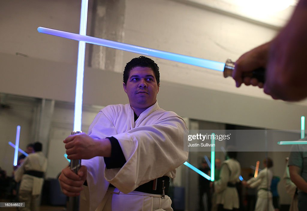 Julio Reyes practices combat moves with a lightsaber during a Golden Gate Knights class in saber choreography on February 24, 2013 in San Francisco, California. Star Wars fans Alain Bloch and Matthew Carauddo founded the Golden Gate Knights in 2011 to teach classes on how to safely wield a lightsaber and perform choreographed moves. The three hour class costs ten dollars and all equipment is provided.