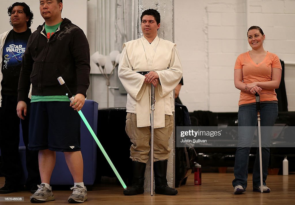 Julio Reyes (C) watches a demonstration during a Golden Gate Knights class in saber choreography on February 24, 2013 in San Francisco, California. Star Wars fans Alain Bloch and Matthew Carauddo founded the Golden Gate Knights in 2011 to teach classes on how to safely wield a lightsaber and perform choreographed moves. The three hour class costs ten dollars and all equipment is provided.