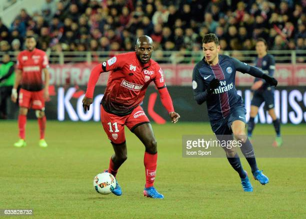 Julio Tavares of Dijon and Hatem Ben Arfa of PSG during the Ligue 1 match between Dijon DCO and Paris Saint Germain at Stade Gaston Gerard on...