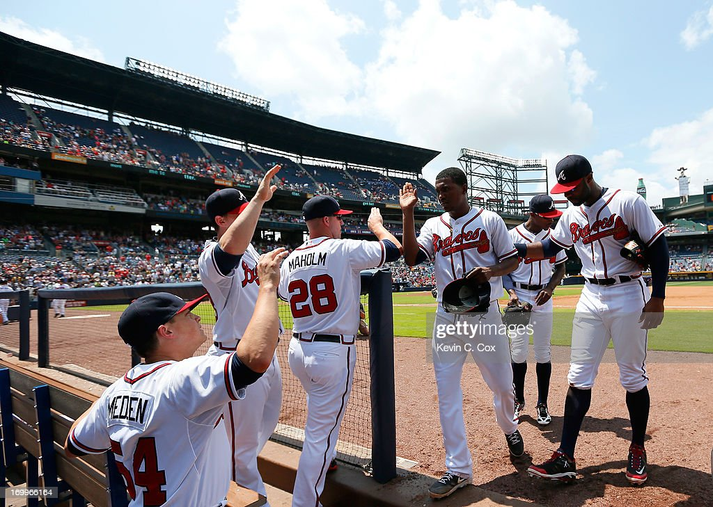 <a gi-track='captionPersonalityLinkClicked' href=/galleries/search?phrase=Julio+Teheran&family=editorial&specificpeople=7091636 ng-click='$event.stopPropagation()'>Julio Teheran</a> #49 of the Atlanta Braves celebrates with teammates after the eighth inning against the Pittsburgh Pirates at Turner Field on June 5, 2013 in Atlanta, Georgia.