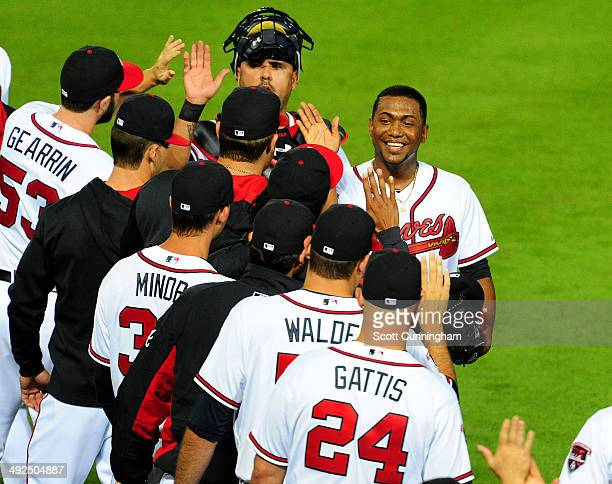 Julio Teheran of the Atlanta Braves is congratulated by teammates after pitching a six hit shutout against the Milwaukee Brewers at Turner Field on...