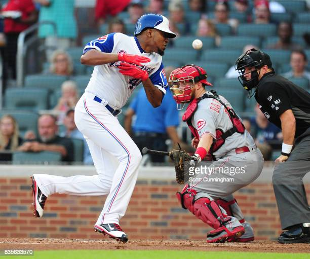 Julio Teheran of the Atlanta Braves is hit by a pitch simultaneously as it hit his bat and after a MLB replay it was ruled a foul tip against the...