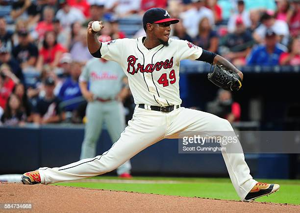 Julio Teheran of the Atlanta Braves throws a first inning pitch against the Philadelphia Phillies at Turner Field on July 30 2016 in Atlanta Georgia