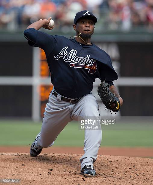 Julio Teheran of the Atlanta Braves throws a pitch in the bottom of the first inning against the Philadelphia Phillies at Citizens Bank Park on...