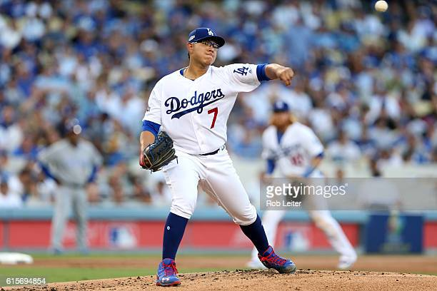 Julio Urias of the Los Angeles Dodgers attempts a pickoff at first base during Game 4 of the NLCS against the Chicago Cubs at Dodger Stadium on...