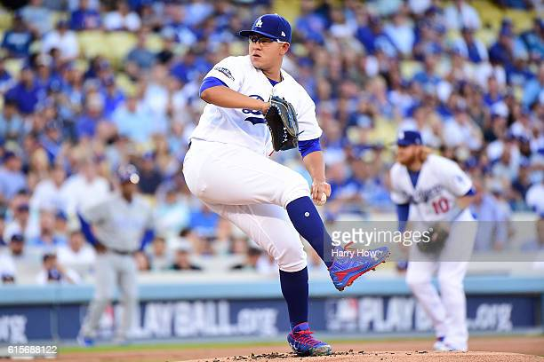 Julio Urias of the Los Angeles Dodgers delivers a pitch against the Chicago Cubs in the first inning of game four of the National League Championship...
