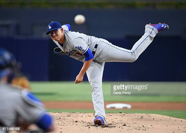Julio Urias of the Los Angeles Dodgers pitches during the first inning of a baseball game against the San Diego Padres at PETCO Park on September 29...