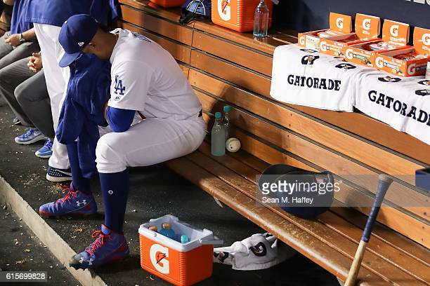 Julio Urias of the Los Angeles Dodgers reacts in the dugout after being taken out against the Chicago Cubs in game four of the National League...