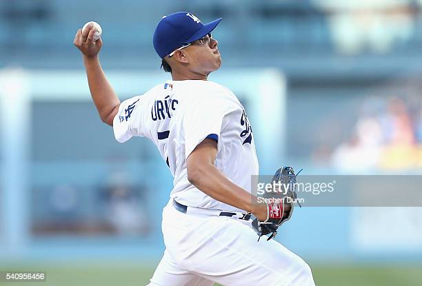 Julio Urias of the Los Angeles Dodgers throws a pitch against the Milwaukee Brewers at Dodger Stadium on June 17 2016 in Los Angeles California