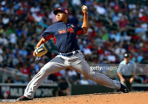 Julio Urias of the World Team pitches against the US Team during the SiriusXM AllStar Futures Game at Target Field on July 13 2014 in Minneapolis...