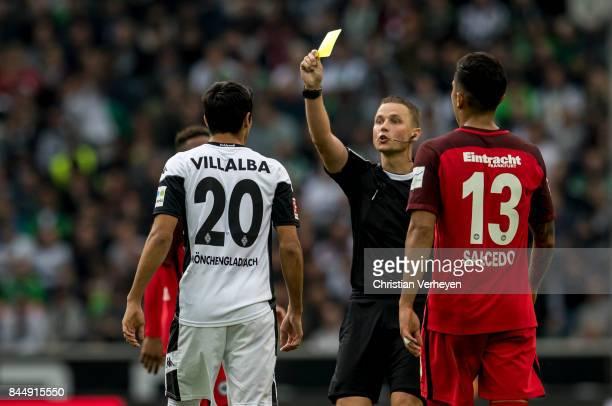 Julio Villalba of Borussia Moenchengladbach gets the yellow card during the Bundesliga match between Borussia Moenchengladbach and Eintracht...