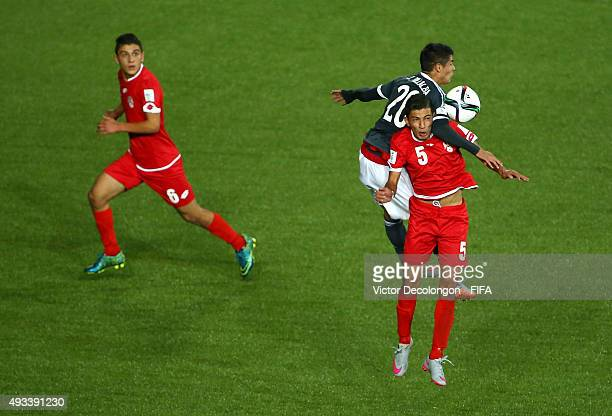 Julio Villalba of Paraguay gets his elbow up on Wasim Alnadaf of Syria during the Syria v Paraguay Group F FIFA U17 World Cup Chile 2015 match at...