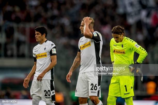 Julio Villalba Raul Bobadilla and Yann Sommer of Borussia Moenchengladbach react after the Bundesliga match between Borussia Moenchengladbach and...