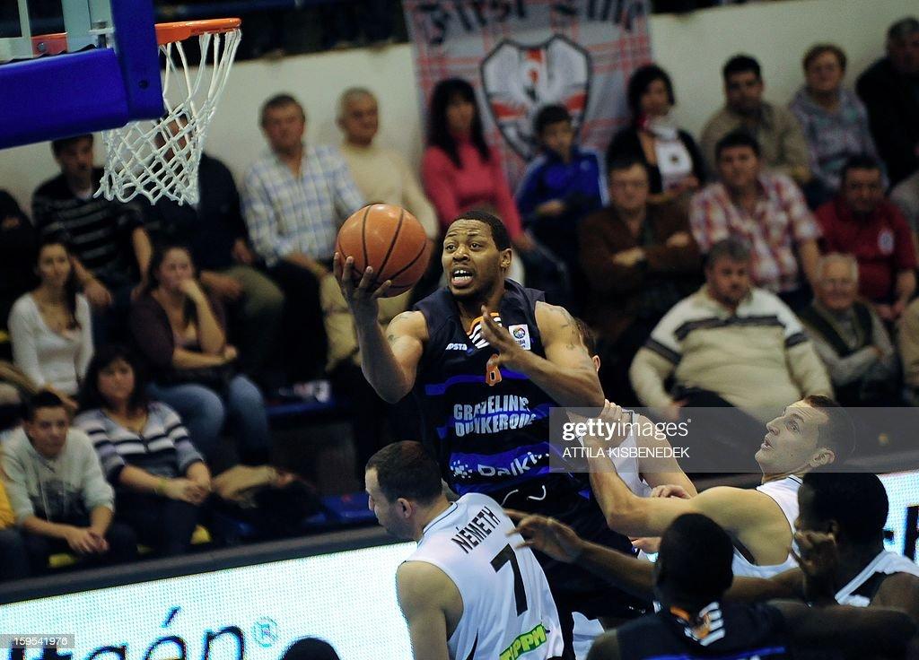 Julis Johnson (L) of French BCM Gravelines Dunkerque scores a basket against Hungarian KK Szolnoki Olaj on January 15, 2015 during their FIBA EuroChallenge match.