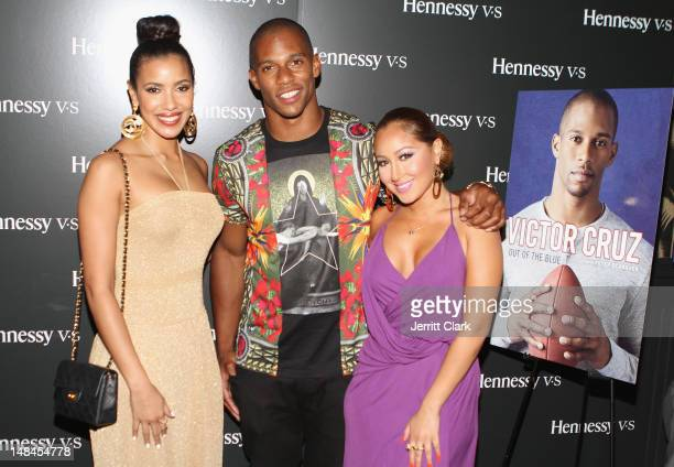 Julissa Bermudez Victor Cruz and Adrienne Bailon attend Victor Cruz Memoir 'Out Of The Blue' Launch presented by Hennessy Vs on July 16 2012 in New...