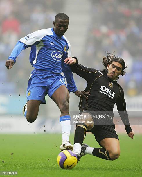 Julius Aghahowa of Wigan is tackled by Pedro Mendes of Portsmouth during the Barclays Premiership match between Wigan Athletic and Portsmouth at the...