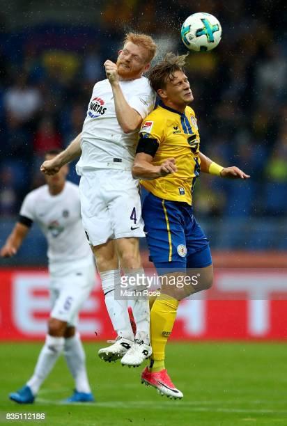 Julius Biada of Braunschweig and Fabian Kalig of Aue head for the ball during the Second Bundesliga match between Eintracht Braunschweig and FC...