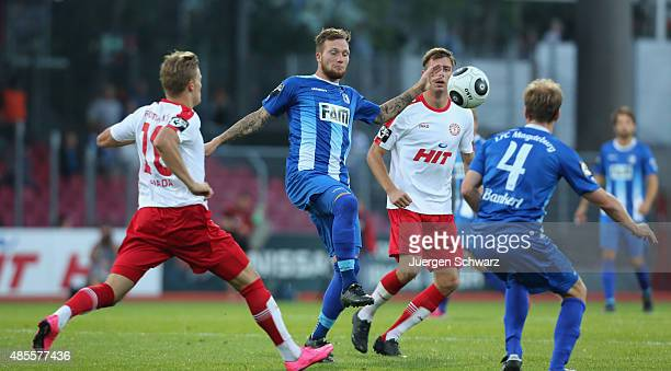 Julius Biada of Cologne Jan Loehmannsroeben of Magdeburg Johannes Rahn of Cologne and Silvio Bankert of Magdeburg fight for the ball during the third...