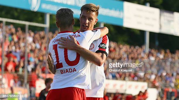 Julius Biada of Fortuna Koeln celebrates the first goal with Johannes Rahn of Fortuna Koeln during the 3 Liga match between Fortun Koeln and Energie...