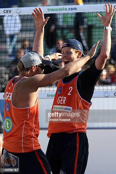 Julius Brink and Jonas Reckermann of Germany celebrate their victory after the men's semi final match between Michal Kadziola and Jakub Szalankiewicz...