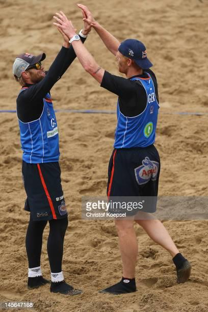 Julius Brink and Jonas Reckermann of Germany embrace after winning the men's final match between Emiel Boersma and Daan Spijkers of Netherlands and...