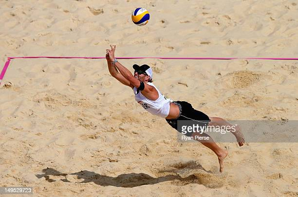 Julius Brink of Germany dives for a shot during the Men's Beach Volleyball Preliminary match between Germany and China on Day 3 of the London 2012...