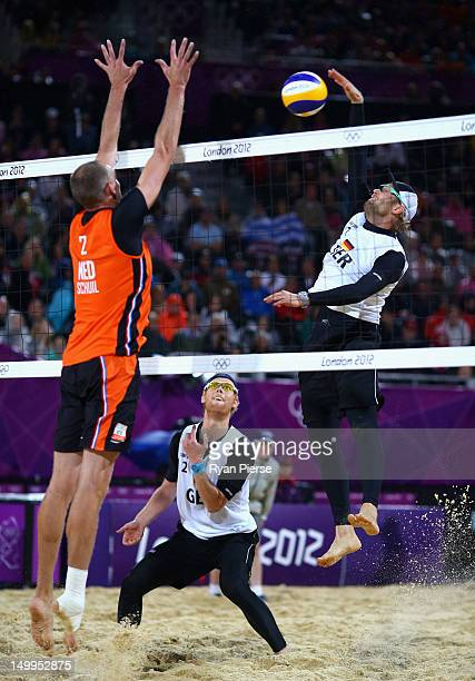 Julius Brink of Germany spikes against Rich Schuil of Netherlands during the Men's Beach Volleyball Semi Final match between Germany and Netherlands...