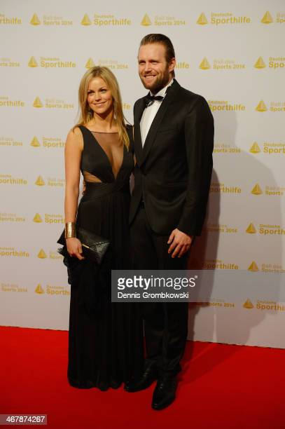 Julius Brink poses with his partner Verena on their arrival at the Ball des Sports 2014 at RheinMainHalle on February 8 2014 in Wiesbaden Germany