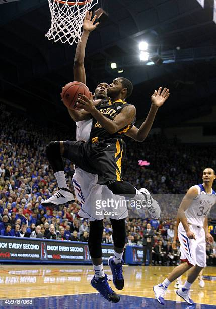 Julius Brown of the Toledo Rockets drives to the goal against Joel Embiid of the Kansas Jayhawks in the second half at Allen Fieldhouse on December...