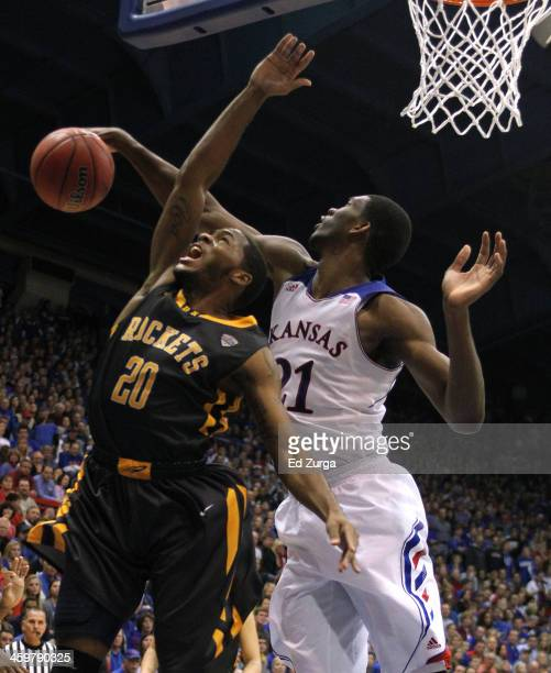 Julius Brown of the Toledo Rockets has his shot blocked by Joel Embiid of the Kansas Jayhawks the second half at Allen Fieldhouse on December 30 2013...
