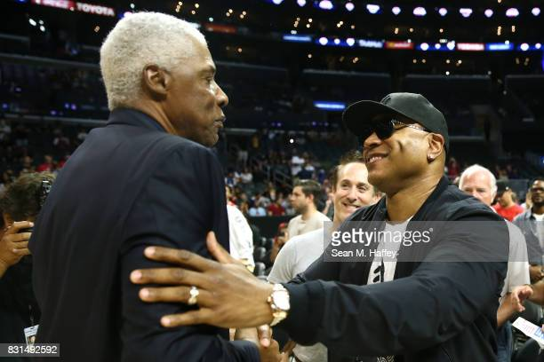 Julius 'Dr J' Erving head coach of TriState speaks with recording artist LL Cool J during week eight of the BIG3 three on three basketball league at...