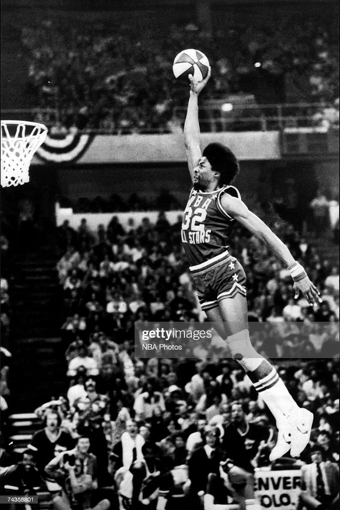 Julius 'Dr. J' Erving #32 of the ABA New Jersey Nets goes for a dunk from the free throw line during the inaugural Slam Dunk Contest during halftime at the 9th ABA All-Star Game on January 27, 1976 at McNichols Arena in Denver, Colorado.