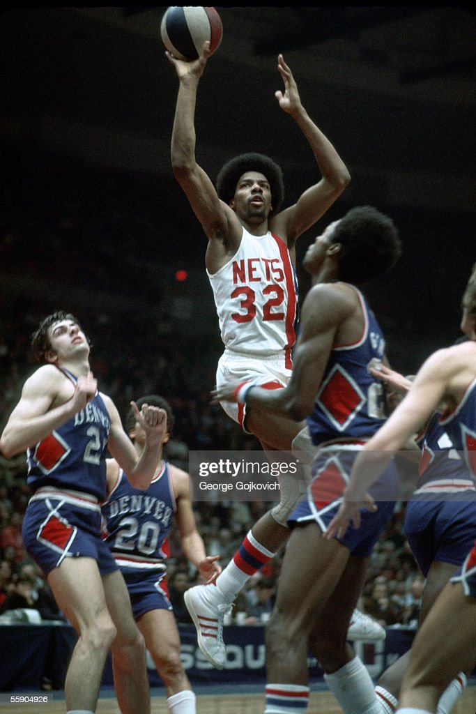 Julius Erving of the American Basketball Association New York Nets takes a shot against the Denver Nuggets during a game at Nassau Coliseum in March...