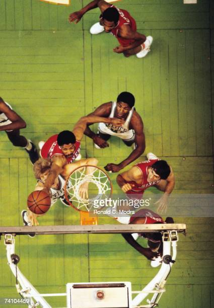 Julius Erving of the Philadelphia 76ers shoots the ball in a game against the Boston Celtics at Boston Garden in 1983 in Boston Massachusetts